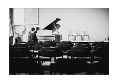 The Concert (Thomas Listl) Tags: thomaslistl blackandwhite biancoenegro noiretblanc concert piano grandpiano pianist music school student window empty solitude chairs emptiness stage 50mm monochrome mood lonely ngc