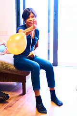 Noe and the Balloon 13 (ArdieBeaPhotography) Tags: girl preteen blue top black hair orange balloon jump leap catch hit purple jeans inside pop highcontrast slim pretty cute fringe arms lift raise bounce string rubber latex toy play fun sit stand socks sox tamronspaf2875mmf28xrdildasphericalif