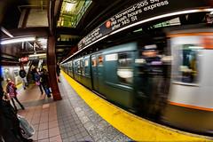 Train of Many Colors In a Blur (skingld) Tags: 34thstreetheraldsquare underground manhattan fisheyelens newyorkcity mta metropolitantransportationauthority christmastime subwaystation historictrain