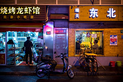 Shanghai life #9 [Explored] (_Franck Michel_) Tags: restaurant chineese writing cinogram night sidewalk menu 434 shanghai bike scooter