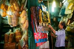 2018-11-03 22-25-30_4481 - Opening her store (trandinhhieu84) Tags: om2n olympus fujicolorc200 hanoi hanoivietnam film streetlife 50mm14mc vietnamese people olympusom2n walkingwithfriends lifeinhanoi lifeinvietnam normal life street store market vendor 50mmf14