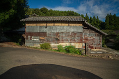 Shadow of greenhouse. (Yasuyuki Oomagari) Tags: 小屋 田舎の風景 shed metal texture light rural country countryside shadow greenhouse landscape facade mountain forest road japan kyushu kumamoto nikon d850 zeiss distagont2821 日本 九州 熊本 サビ