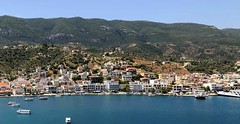 clock tower view of the town of Galatas across the strait IMG_1414 (mygreecetravelblog) Tags: greece greekislands greekisland poros porosisland porosgreece saronic saronicgulfisland outdoor landscape water sea saronicgulf hills mountains town village galatas strait
