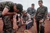 Vietnam War 1969 - Soldiers Listening to Portable Radios