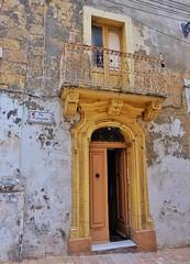Maltese Doors (Douguerreotype) Tags: yellow city balcony buildings malta architecture valletta urban door