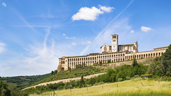 Assisi (Andrea Rizzi Esk) Tags: assisi landscape sky chirch italy umbria grass colorful orton effect clouds bulding architecture house