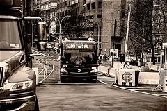 "Street Scene In Manhattan Near Brooklyn Bridge Area (nrhodesphotos(the_eye_of_the_moment)) Tags: dsc11283001084 ""theeyeofthemoment21gmailcom"" ""wwwflickrcomphotostheeyeofthemoment"" monochrome mta bus reflections shadows outdoors streetscene buildings roadway metal streetsigns"