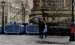 Sharing (Fermat 48) Tags: albertsquare manchester umbrella rain sharing canon eos7dmarkii cobbles street lamps lights
