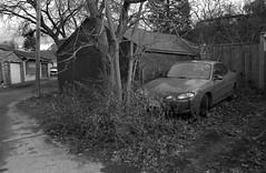 Alley (geowelch) Tags: toronto dundasstwest alley garage winter automotive car blackandwhite 35mmfilm kodaktmax100 hc110 monochrome analog pentaxk2 pentaxtakumara28mm28 plustekopticfilm7400 urbanfragments newtopographics