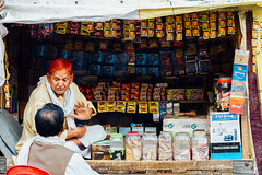 Man With Dyed Hair Talking, Etawah India (AdamCohn) Tags: 056kmtoetwahinuttarpradeshindia adamcohn etwah india uttarpradesh conversation geo:lat=26779589 geo:lon=79017151 geotagged henna man shopkeeper store streetphotographystreetphotographer talking wwwadamcohncom etawah