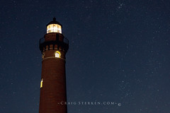 Starry Night at Little Sable Lighthouse in Michigan (Craig - S) Tags: greatlakes lakemichigan light lighthouse littlesable beach beauty nature night outdoors reflection sand shore sky stars sunset tourism travel watersilverlake sanddunes dunes starry tower brick photography rail mears michigan unitedstates us