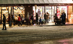 Christmas Shoppers (wyojones) Tags: wyoming cody christmas christmasparade cowboychristmas shoppers snow stores stroll shopping lights people wyojones