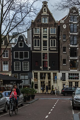 Amsterdam (Adrià Páez) Tags: amsterdam holland noordholland northholland the netherlands nederland europe dutch architecture bicycle cycling city center street capital road cars child kid girl windows buildings houses canon eos 7d mark ii