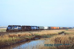 CR 3131-3256-3135, IHB7, E Rutherford, NJ. 5-06-1977 (jackdk) Tags: train railroad railway emd emdgp40 emdgp402 gp40 gp402 erie erielackawanna cr conrail croxton meadow meadowlands seacaucus rutherford eastrutherford freighttrain freight fallenflag standardcab penncentral pc
