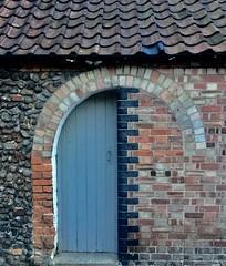 Hidden In Holt (NJKent) Tags: blue arch brickwall bricks door wall holt norfolk uk
