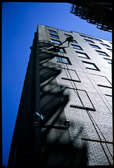Window Washer, Indianapolis, Indiana (Roger Gerbig) Tags: indianapolis indiana windowwasher skyscraper rogergerbig rdpiii fujichromeprovia100f fujigw690ii texasleica 120film 6x9 fullframe