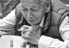 cherished habits (Georgie Pauwels) Tags: portrait street streetphotography hongkong somking playing game candid