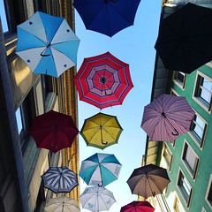 umbrellas (Rosmarie Voegtli) Tags: basel baselcity umbrellas schirme sky buildings hanging odc ourdailychallenge colours colors colorful inexplore