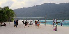 Playing a game of beach volleyball on Koh Lipe (B℮n) Tags: kolipe kohlipe เกาะหลีเป๊ะ kohlippy adangrawi archipelago ploysiam speedboat national park kohturatao koturatao kohlipeh nationalparkkohtarutao tarutao bounty island thailand anadamansea sandy beach pakbara marinepark snorkling adang rawi tourism vacation holiday coral reef tropical fish nemo protectedarea chaolay chaoley boat palmtree coconuts crystal clear water seawater siam seagypsies longtail nature reserve province satun blue cyan thai sunrise bulowbeach deserted girl woman sunbathing lowseason rainyseason relax paradise swimming solitude volleyball beachvolleyball 50faves topf50