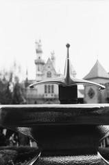 Arthur's Sword (dualdflipflop) Tags: disneyland disney film 35mm disneylandcastle f100 nikon nikonf100 filmphotography blackandwhite bw sword castle