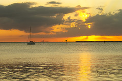 Trading Wind Power for Motor Power (SteveFrazierPhotography.com) Tags: sailboat yacht boat motor channel markers shoreline horizon clouds sunset rays beam light waves beautiful charlotte bay harbor county poncedeleon historicalpark stevefrazierphotography canoneos60d