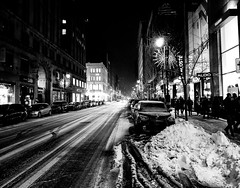 Rue Saint-Catherine Winter Night (MassiveKontent) Tags: noiretblanc blackwhite montreal bw city monochrome urban blackandwhite streetphoto montréal quebec street photography bwphotography streetshot night nightshot shadows blancoynegro metropolis cityscape cityatnight streetlight road people car building winter snow absoluteblackandwhite frozen mono cold