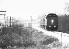 Backlit Success - Shubenacadie East, NS (CWentzell Photography) Tags: via rail railroad railway passenger train track f40 emd gm motivepower locomotive locomotives engines engine black white monochrome snow january 2019 winter canon photography novascotia shubenacadie stewiacke signal telegraph pole canada canadiannational bedford sub subdivision hot box detector
