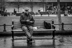 The Picnic (Leanne Boulton) Tags: people urban street candid portrait bench sitting portraiture streetphotography candidstreetphotography candidportrait streetportrait streetlife sociallandscape man male face expression mood atmosphere winter food eating snack wet weather tone texture detail depthoffield bokeh naturallight outdoor light shade city scene human life living humanity society culture lifestyle canon canon5dmkiii 70mm ef2470mmf28liiusm black white blackwhite bw mono blackandwhite monochrome newcastle newcastleupontyne england uk