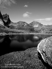 Fageråvatnet View (liamearth) Tags: earth reine lake shore sky clouds mountain sceneic wilderness beautiful view outdoor water western landscape wild lofoten norway arctic circle traveling moskenesøya real life camping serene mountainside bw blackandwhite monochrome still clear texture contrast veil skjelvtinden cliff bay angle rock reflection darkwaters grass
