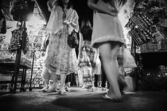 Flow (Rob₊Lee) Tags: urbanpoetry poetry urban people street night market monochrome blackandwhite lowangle motionblur motion blur traffic nightmarket noireblanc shopping shops stalls ground level