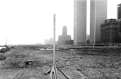 Low resolution Battery Park City bleak wasteland on a gray and rainy day. Not a trace of North Cove, South Cove, the Hudson River walkway... just 92 acres of moist muck. Nice view of the recently completed World Trade Center. New York. March 1973 (wavz13) Tags: newyorkphotographs newyorkphotos urbanphotography urbanphotos newyorkphotography manhattanphotography manhattanskyline newyorkskyline newyorkskyscrapers manhattanskyscrapers urbanlife newyorklife manhattanlife lowermanhattan lowerwestside city analog vintageanalog 1970sanalog swampy blight blighted weeds weedy oldphotographs oldphotos 1970sphotographs 1970sphotos oldphotography 1970sphotography oldnewyorkphotography oldnewyorkphotographs oldnewyorkphotos vintagenewyorkphotography vintagenewyorkphotographs vintagenewyorkphotos oldworldtradecenter vintageworldtradecenter twintowers originalworldtradecenter vintagetribeca oldtribeca depressing bleak noir noire dark urbanscenes 110film analogphotography filmphotography instamatic pocketinstamatic urbanwasteland urbanblight manhattanhistory newyorkhistory vintagemanhattan oldmanhattan vintagenewyork oldnewyork newyorkskyscapers 1970smanhattan 1970snewyork urbanlandscapes tribeca