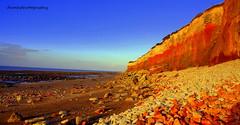 Hunstanton Sunset (damhphotography) Tags: sun sunset nature sky light sea stones norfolk hunstanton