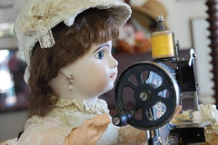 Little Seamstress (Emily1957) Tags: jumeau doll dolls antique sewing sewingmachine toys toy light naturallight nikond40 nikon kitlens french frenchdoll germansewingmachine bisque