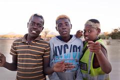 Three Tribal Ambassadors _6082 (hkoons) Tags: southernafrica boysandgirls africa african boy namibia child children game games girl kids play recreation youth