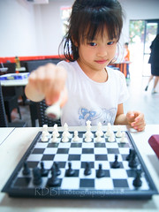 Basketball Day GuoGuo 11 (ArdieBeaPhotography) Tags: small little girl child kid young elementary schoolage primary play fun cheeky mischievous active busy friendly cute pretty white tshirt daughter chess board pieces move strategy