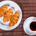 A plate with croissants and a Cup of tea, Breakfast concept