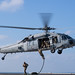 Sailors conduct a fast rope exercise from an MH-60S Sea Hawk helicopter from aboard the USS John C. Stennis