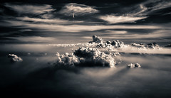 Cloud of this World (Carl's Captures) Tags: clouds sky layers backlight monochrome shadows aerial elevation elevated vista landscape skyscape patterns abstract sepia firmament heavens skies upperatmosphere view flight aviation weather formations heights cloudsinmycoffee splittones popcorn àlamode meltingbutter cottagecheese dreamy fantastical shadowy drama dramatic nikond7500 sigma18300 photoshopbyfehlfarben thanksbinexo