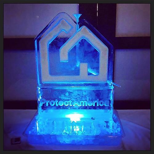 @protectamerica hosted a festive #holiday #party @estanciasteakhouse to kick off the season! #fullspectrumice #icesculpture #luge #logo #thinkoutsidetheblocks #brrriliant #branding - Full Spectrum Ice Sculpture