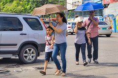 Service is over (Beegee49) Tags: street family smiling umbrella walking cars filipina sony a 6000 happy planet bacolod city philippines asia luminar
