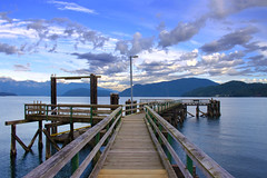 Hopkins Dock, Gibsons, British Columbia (Jordan Jamieson) Tags: hopkins dock gibsons bc britishcolumbia canada sunshinecoast ocean islands mountains hopkinsdock lightpost seagull clouds sky wood wharf pacific pacificocean northshore