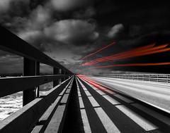 a faint memory of a truck passing by (marianna armata) Tags: p2650576 truck lights red bright bridge fence light shadow moonlight dark night maria marianna armata