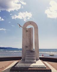 Summer dreamy summer (laclairvoyance) Tags: door sea summer memories blue seagull art sculpture artist clouds sunny august