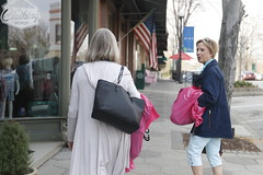 Shirley Turner (left), 71, retired, from Thomasville, Georgia, and Donna Bradner (right), 66, retired, from Atlanta, Georgia, leave Maggie Lane with their pink shopping bags in hand. They were visiting a friend and came shopping