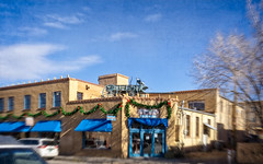 Somebody has arrived (Tiigra) Tags: santafe newmexico unitedstatesofamerica us 2018 architecture balcony blue carriage city funny object ornament roof store usa wood