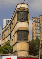 Art Deco Building In Kunming, Yunnan Province, China (Eric Lafforgue) Tags: a0005777 architecture artdeco asia buildingexterior china city colorpicture corner curve day lowangleview nopeople outdoors vertical yunnan yunnanprovince kunming