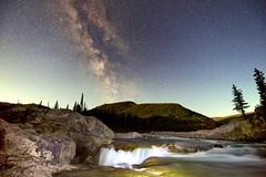 Elbow Falls Milky way (John Andersen (JPAndersen images)) Tags: alberta aurora elbowfalls kananaskis logs night pond rocks sky smoke stars trees