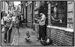 Dancing to the Fiddler's tune! (steve.gombocz) Tags: street nikon nikond810 nikonusers nikoneurope nikonbw nikonfx nikon2401200mmf40 zwartwit neroebianco sortoghvid mustavalkoinen svarthvitt svartoghvitt svartochvitt pretoebranco noiretblanc schwarzundweiss negroyblanco noirblanc schwarzweiss negroblanco pretobranco nerobianco urbanstreet blacknwhite greyscale monochrome streetscene blackwhite bwphotos bwstreetscenes bw bwstreet flickrbw bwflickr blackwhitephotos blackwhitephotography flickrstreet blackwhitestreet bwstreetphotography streetlife blackandwhite streetphotographs bwphotographs streetphotography bwphotography streetbw photosinblackandwhite bwpicture flickraddicts blackandwhitephotographs purestreet out outandabout streetpictures streetphotos flickr exploreflickr fiddler puppet whitby whitbybw explorewhitby flickrwhitby busking streetbusker