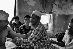 Socotri Healer (Rod Waddington) Tags: yemen yemeni socotra island socotri healer health islam house indoor blackandwhite monochrome mono men people group traditional tribe tribal