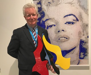 Art dealer David Hayes with his father, David Hayes' sculpture at the Art Miami opening